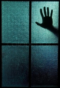 2489184-silhouette-of-a-hand-behind-a-window-or-glass-door-symbolizing-horror-or-fear